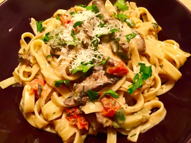 Lemon, garlic and mushroom pasta with herbs, courgette and tomatoes