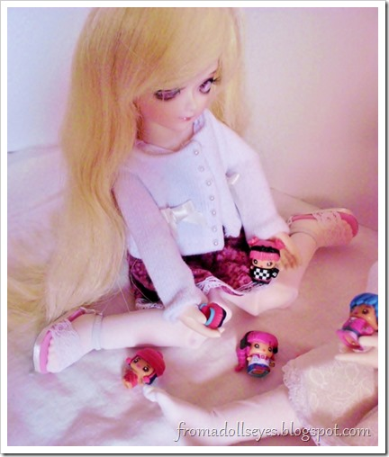 Dolls playing with dolls.