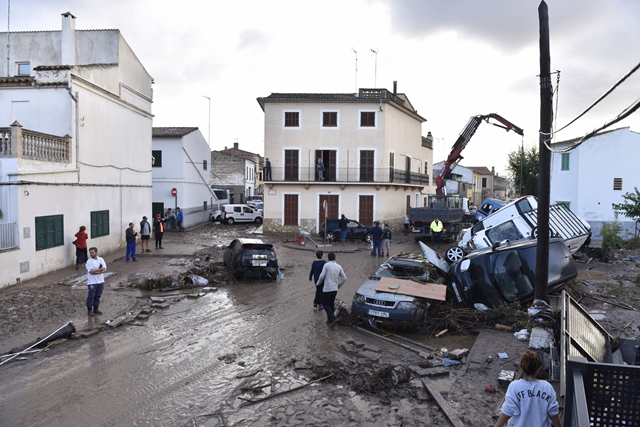 Cars are piled up by a flash flood in Sant Llorenç des Cardassar, 10 October 2018. The flood cut off the Majorca town of Sant Llorenç des Cardassar, which is home to about 8,000 people and is about 40 miles from Palma, the Spanish island's capital city. Photo: Atienza / EPA / Shutterstock
