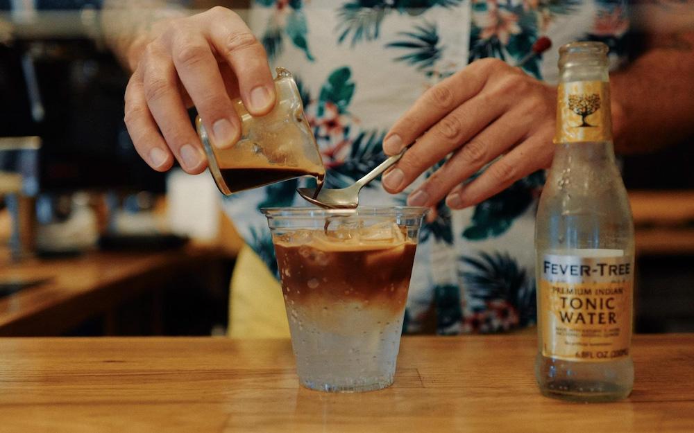 barista pouring espresso tonic