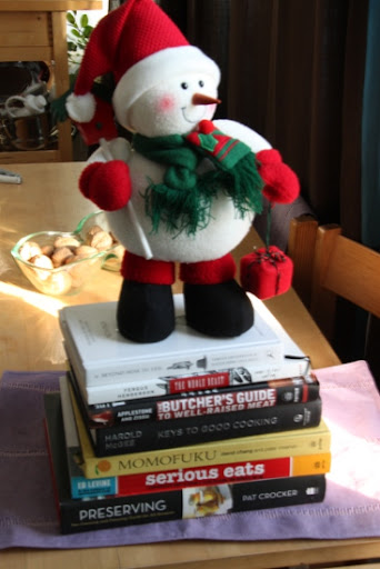 Frost the Snowman on top of a stack of cookbooks