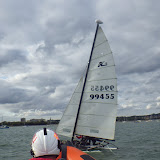 16 August 2014 - Poole ILB escorting a Hobie cat after it had capsized and was taking on water in one of its hulls. Photo: RNLI Poole/Steve Porter