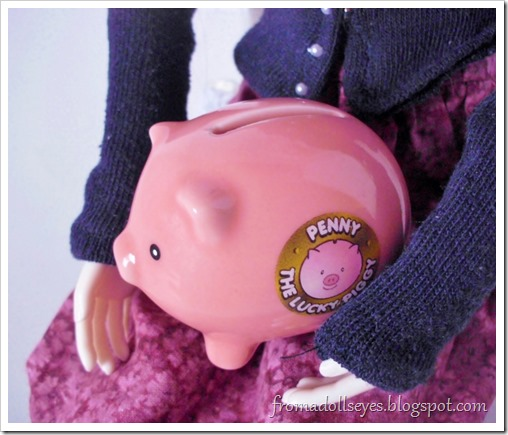A tiny doll size piggy bank.