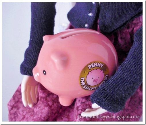 A tiny doll size piggy bank.