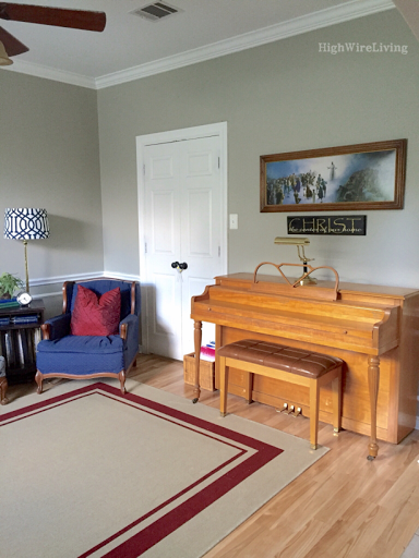 living room navy arm chair spinet piano