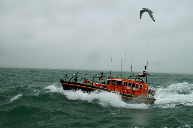 Swanage Mersey class lifeboat with her Jonathan Livingstone Seagull moment in rough weather - 26 January 2014 Photo: RNLI Poole/Rob Inett