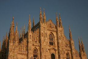 Upper facade of Milan Cathedral at sunset