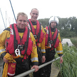 8 June 2012: Crew Members James Kilburn, Rob Inett and Mark Ponchaud wearing their new lifejackets for the first using them. Photo: RNLI Poole/Dave Riley