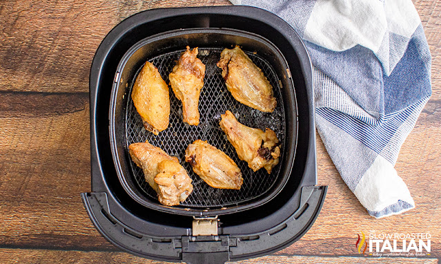 baked chicken wings inside the air fryer basket