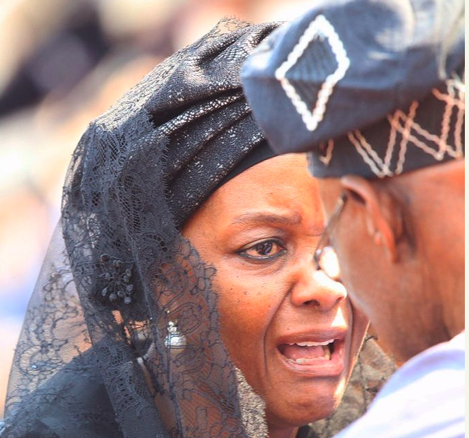 Tears: Ex-Zimbabwean First lady, Grace Mugabe cries to Obasanjo at Funeral Service [PHOTO]
