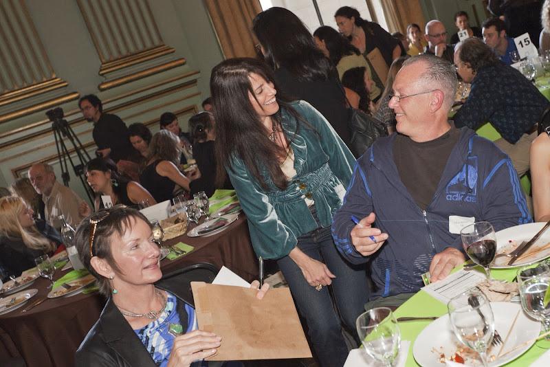 Guests conversing, including Tish Momirov and Allan Badiner. Photo by Eric Slomanson/slomophotos.com - Copyright 2010.