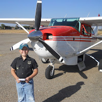 Andrew in front of the Cessna 206.