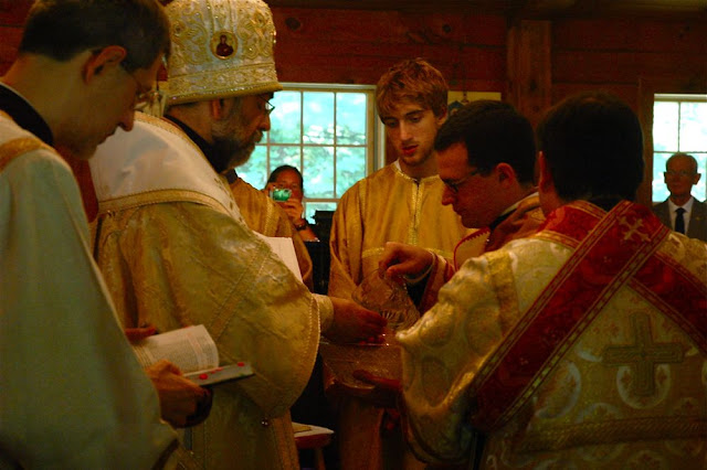 The new subdeacon washes the Bishop's hands as a sign of humility.