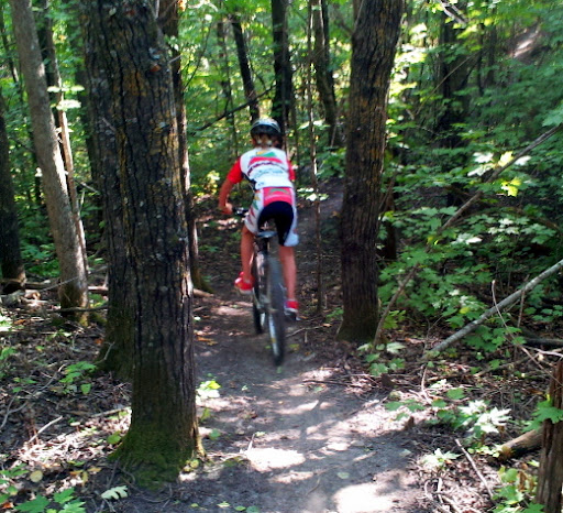 Riding through the trees at start of new twin lakes singletrack