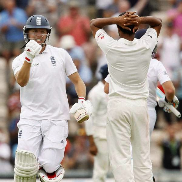 England's Gary Ballance (L) celebrates after reaching a century (100 runs) during the first day of the third cricket Test match between England and India at The Ageas Bowl cricket ground in Southampton on July 27, 2014.