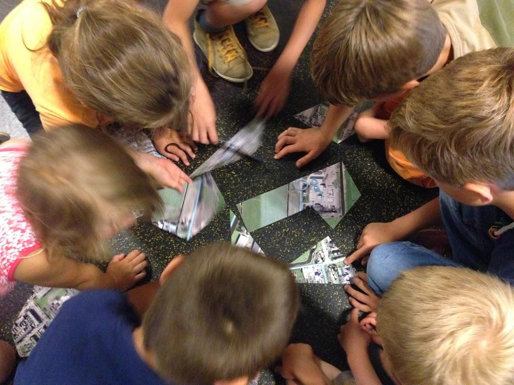 Bij elk spel konden ze puzzelstukjes verdienen en uiteindelijk de puzzel maken.