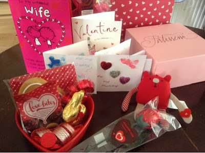 range of valentine's themed items including chocolates, cards, soft toy and handmade cards.