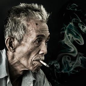 Sg Ud Man by Naising Bega - People Portraits of Men ( smoking man, square, portrait, smoke )