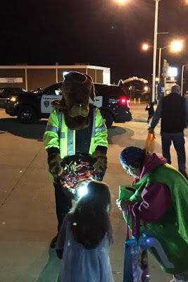 Lebanon Police and McGruff the Crime Dog visited various neighborhoods on Halloween night handing out candy and glow sticks to the trick or treaters.