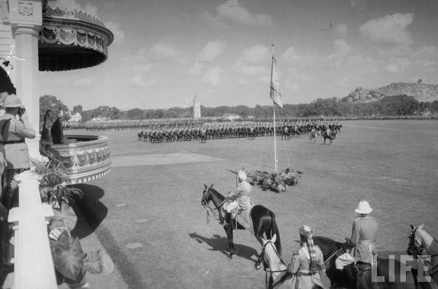 Mir Osman Ali Khan, reviewing the troops march from the royal box (probably in Parade ground Secunderabad)