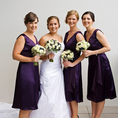 Aimee's purple silk-satin bridemaids.
