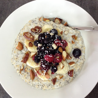 Coconut Porridge topped with Berries + Nuts