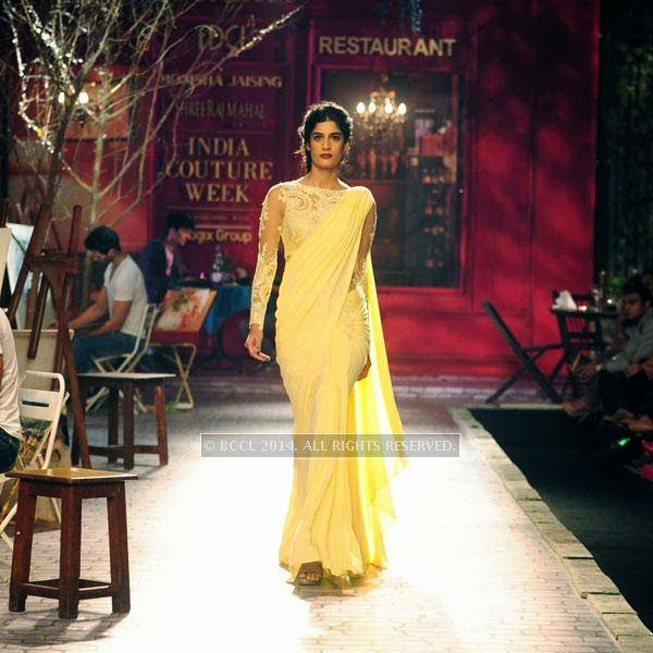 Erika walks the ramp for Monisha Jaisingh on Day 3 of India Couture Week, 2014, held at Taj Palace hotel, New Delhi.