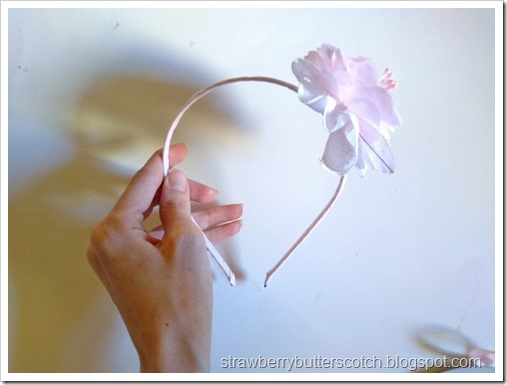 Making a flower and lace headband.  Use some ribbon and glue to attach the flower piece to the headband