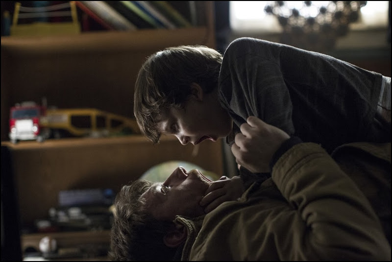 Gabriel Bateman and Patrick Fugit in Outcast