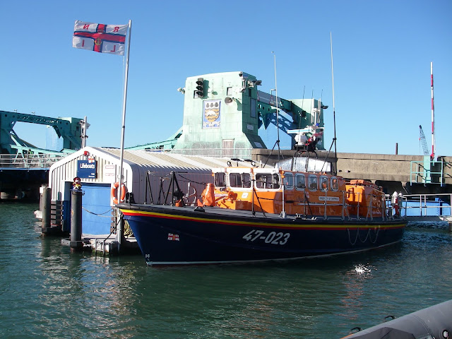 Poole's Tyne class lifeboat moored next to the floating boathouse next to Poole Lifting Bridge, Poole Quay