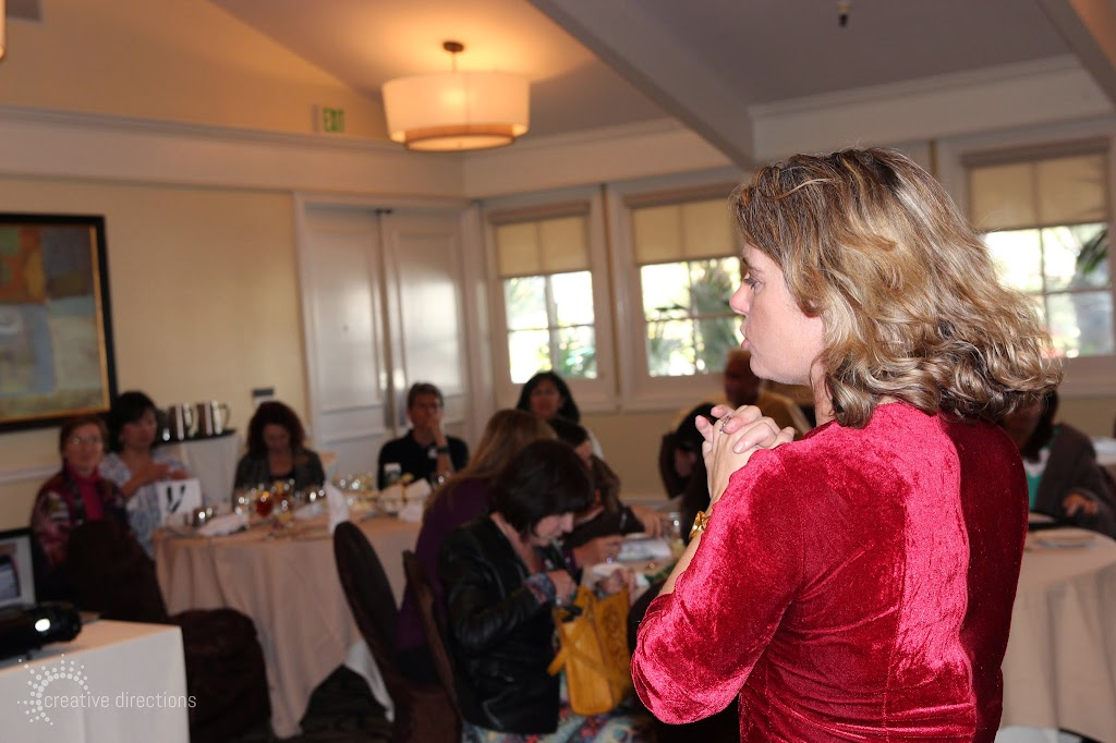 women's wisdom judy foster jan14 luncheon nadie lajoie speakind to group