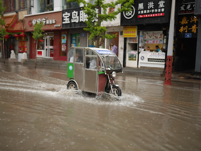 motor-rickshaw on a flooded street in Taiyuan, China
