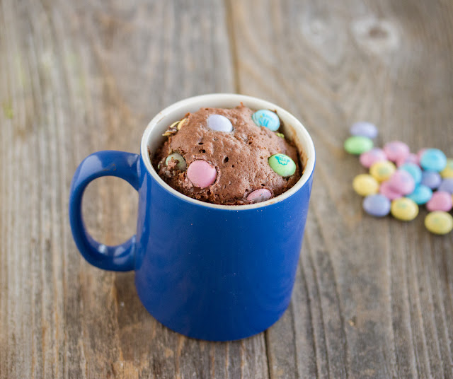 overhead photo of easter candy mug cake