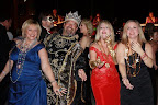 The king parties with some Mardi Gras celebrants.