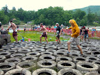 The first few guys in Julie's heat navigating the tires. Cannot believe that guy did the whole race in that lion costume.