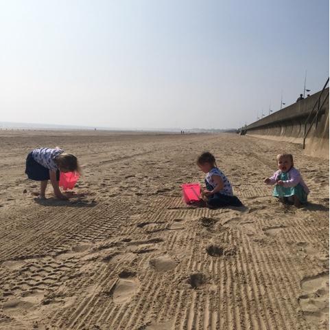 Siblings Beach combing on Bridlington Beach