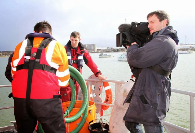 Poole trainee Crew Member Anthony Skerman looking on (centre) as ITV filmed to promote the RNLI's apprenticeship programme during National Apprenticeship Week (3-7 March 2014). Photo: RNLI