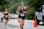 Running up the hill. Man, I need to work on my form! Photo courtesy of the Adams Realty race photographer.