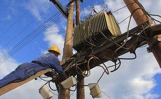 Kenya Power workers fitting transformers. PHOTO| NMG