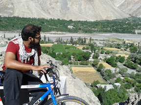 Time to rest and watch the breath-taking view of a village on KKH.