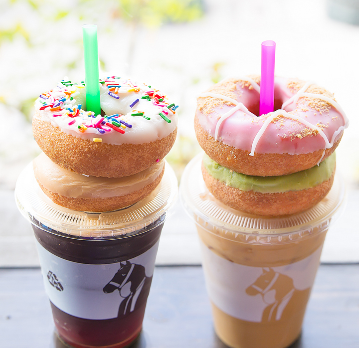 Nitro Cold Brew and Salted Maple Iced Cold Brew Latte drinks with donuts ontop