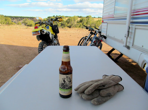 Enjoying a beer after setting up camp