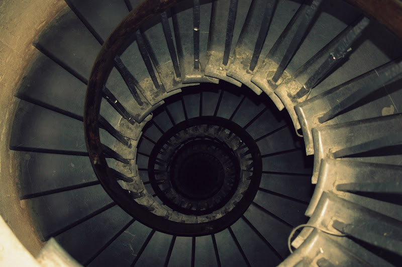 Photo: The stairs inside the Monument in London, taken from the very top. 311 steps. The hand rail that follows the stairs down is actually a wonderful part of Monument, especially after climbing a similar set at the Sagrada Familia where there is no such thing. Safety if sometimes overrated!