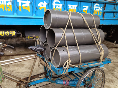 "Transportation of the empty PVC pipe shells from the BRB Cables via Rickshaw ""van"""