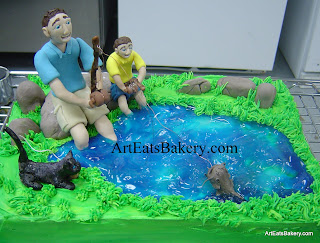 Father and son fishing in a pond with their cat custom birthday cake design