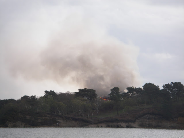 20 April 2012 - Flames clearly visible from the four-storey building on Green Island as Poole's all-weather lifeboat heads to the scene to provide back-up for medical evacuation of firefighters if required. Photo: RNLI/Poole Lifeboat Station Anne Millman