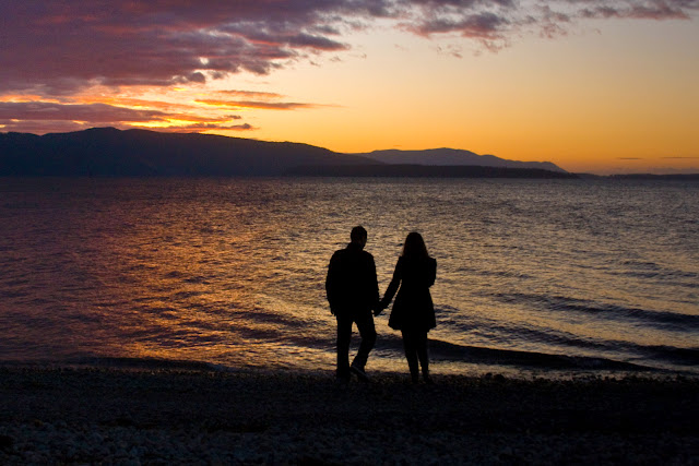 A newly engaged couple looks out over Bellingham Bay at sunset /  Credit: Shannon McGuire
