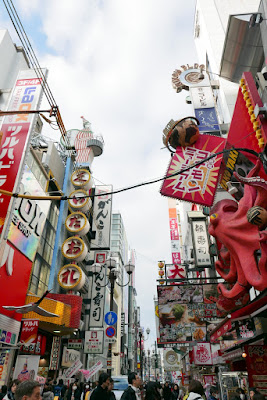 Sights of Osaka - including to the left in this photo Kuidaore Taro, the famous drumming clown.