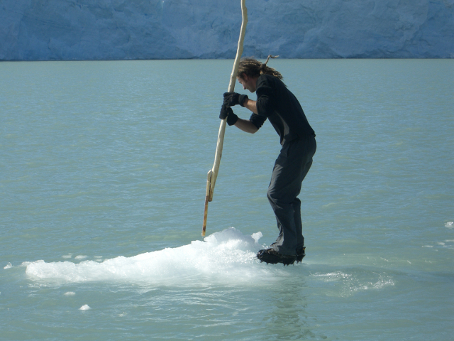 man rowing an iceberg on a lake in Patagonia