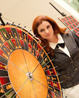 Jennifer Shahade with the roulette chess wheel she created with Larry List. Photo Betsy Dynako